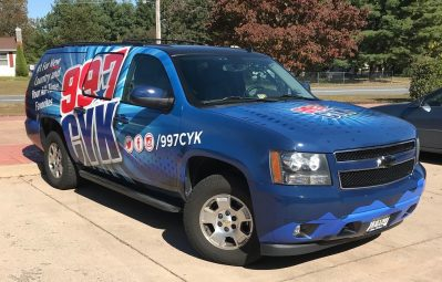 99.7 CYK full color print installed wrap