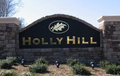 Holy Hill neighborhood entrance 3d gold lettering and logo