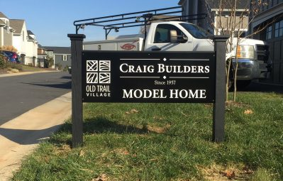 Old Trail Village model home exterior sign