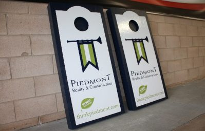 Piedmont realty branded cornhole game sign