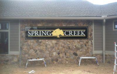 Spring Creek gold neighborhood entrance sign