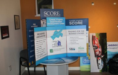 Small business development convention booth tri-fold signage full color printed design