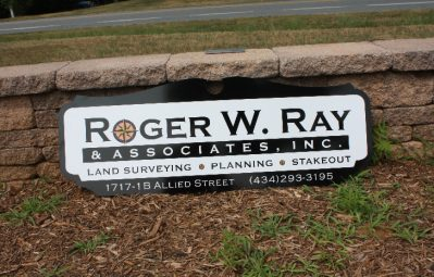 Roger W Ray custom shaped exterior sign