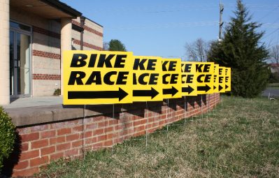 Bike race coroplast step stake event directional signs